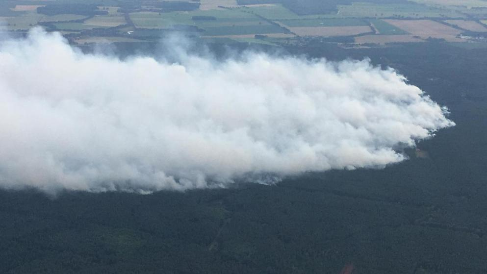 Massive evacuation in Germany as fire threatens munitions warehouse